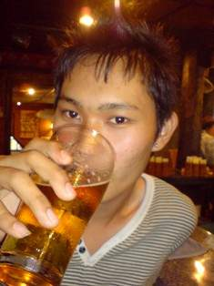 Draught Tiger Beer being drunk by cute Bon Tong boy Ice at the Pub