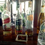 Whiskey Bottles at Radchada Garden Cafe