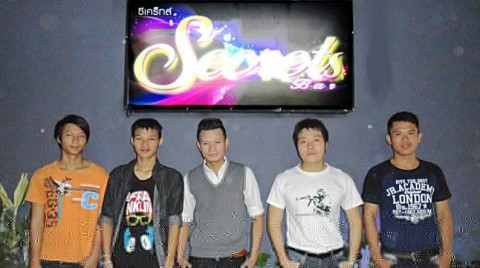 Secrets gay party - bar boys waiting to greet you