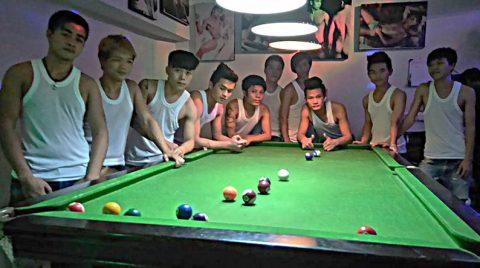 Sexy boys playing pool at Secrets Gay Bar Chiang Mai