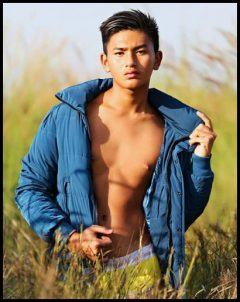 cute burma boy in hayfield with yellow underwear