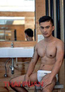 Cute thai guy in sexy underwear in bathroom